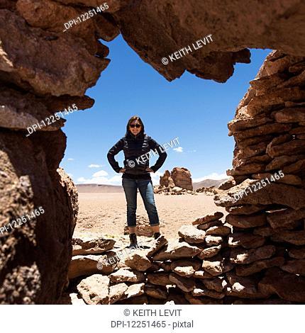 Portrait of a woman standing in Salar de Atacama; San Pedro de Atacama, Antofagasta Region, Chile