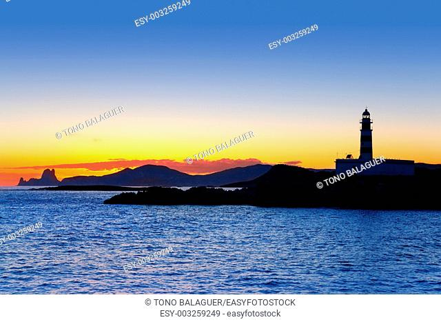 Ibiza island sunset lighthouse and Es Vedra in background