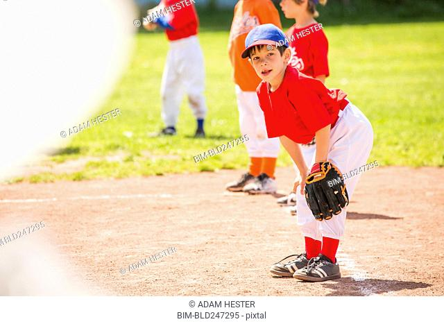 Mixed Race boy playing baseball