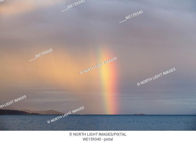 Canada, BC, Sunshine Coast. Vertical rainbow in the Strait of Georgia