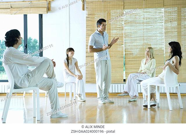 Man leading group therapy session