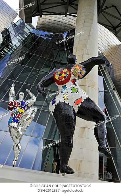 temporary exhibition of ''Nanas'' by the French artist Niki de Saint Phalle 1930-2002 at the Guggenheim Museum designed by architect Frank Gehry, Bilbao