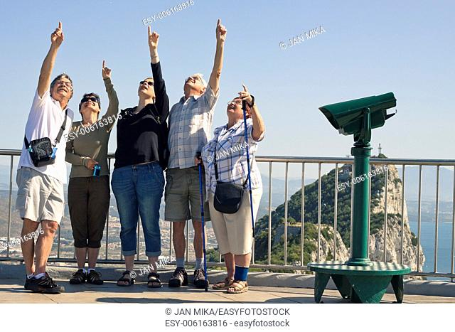Portrait of happy excited tourists people on the Rock of Gibraltar