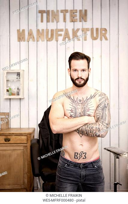 Portrait of man with tattooed upper body