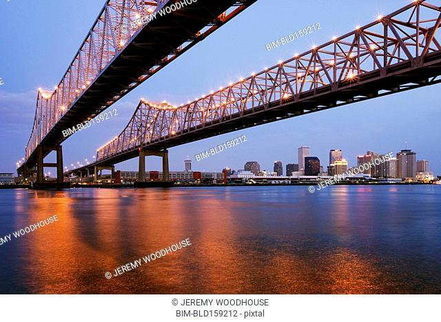 Low angle view of bridges over urban river, New Orleans, Louisiana, United States