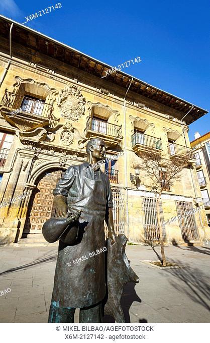 wineskin bottle maker statue and palace in Plaza de la Cruz. Haro. La Rioja. Spain