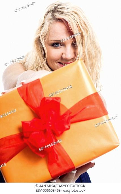 Closeup of happy blond woman holding orange gift box, isolated on white background