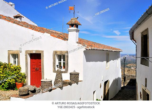 House with red door in a pretty street of Marvão in the Alentejo, Portugal