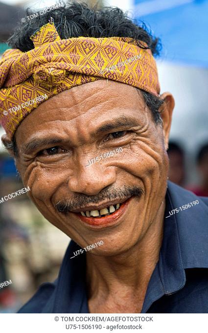 man in market waitabula sumba indonesia