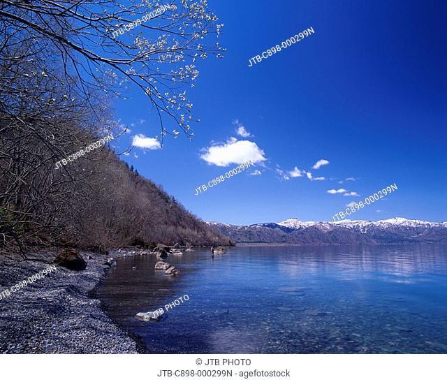 Unmelted snow Blue sky Clouds Mountain Spring Lake Shikotsu Hokkaido Japan