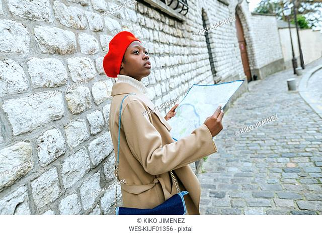 Young woman in Paris with city map