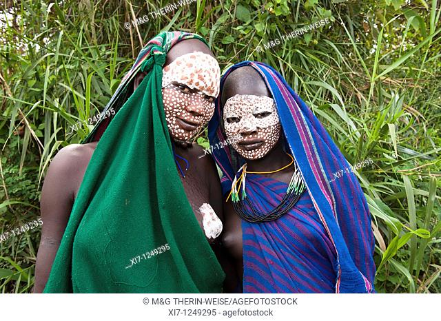Two young Surma women with traditional body paintings, Kibish, Omo river, Ethiopia Z