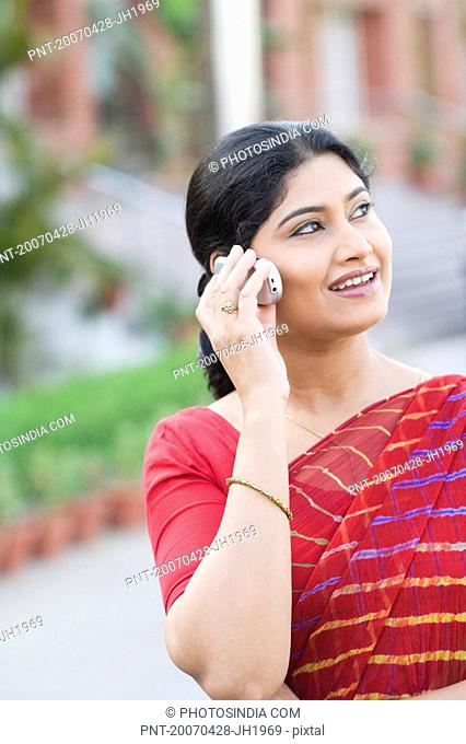 Close-up of a teacher talking on a mobile phone and smiling