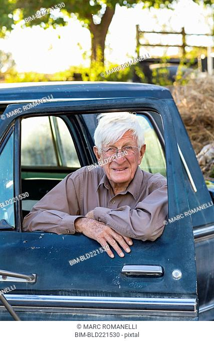 Older Caucasian man sitting in truck