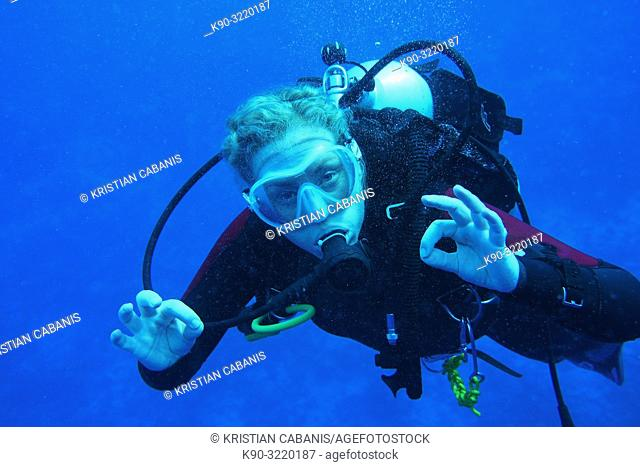 Close up of femal diver showing the ok sign