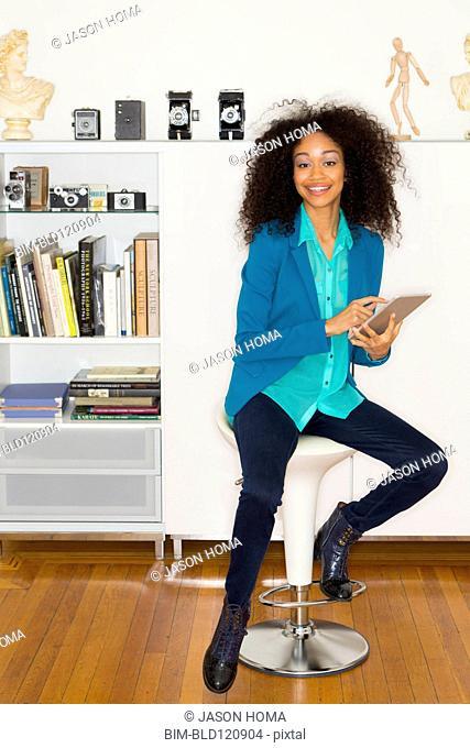 Mixed race woman using digital tablet