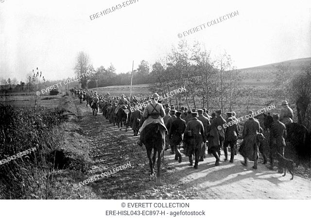World War 1: Battle of Verdun. German prisoners being escorted to confinement behind the lines of the Battle of Verdun. Ca. 1916. (BSLOC-2013-1-104)