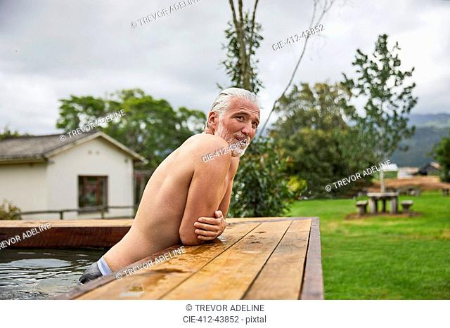 Mature man relaxing in hot tub