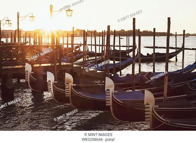 Gondolas moored in the Canale Grande in Venice, Veneto, Italy at sunrise