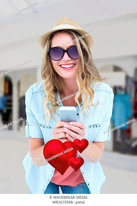 Happy woman text messaging on mobile phone