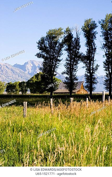 Barn with Tetons in the background near Jackson, Wyoming, USA