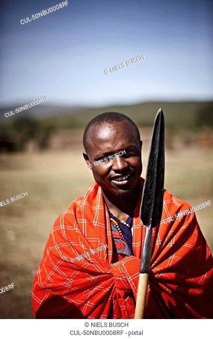 Maasai man holding shovel