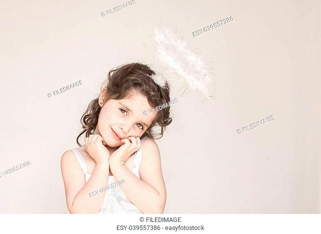A little girl enjoying her angel halo and outfit at Christmas