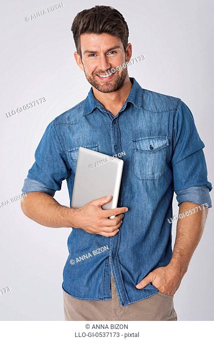 Fashion man with contemporary digital tablet. Debica, Poland