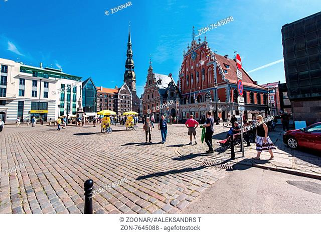 Riga, Latvia- August 20, 2015: Day view of the Town Hall Square and the Blackheads House. The building of the Brotherhood of Blackheads is one of the most...