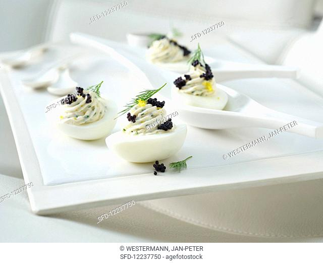 Russian eggs with herbs and caviar