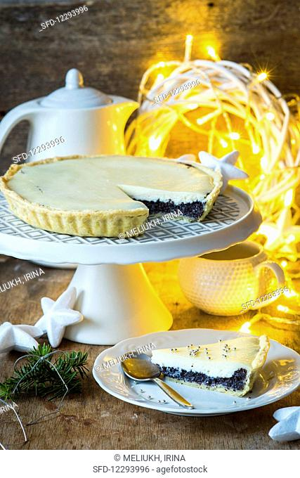 A Christmas poppy seed tart with a slice cut out