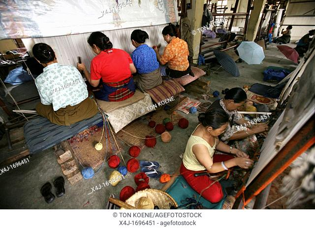 Tibetan women working in a carpet weavery in Nepal Most carpets are being exported to the West