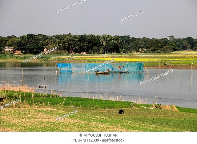 Bangladesh is crisscrossed with rivers and canals It is a common scene in the rural especially the lowland areas to see people busy catching fish Gopalgonj