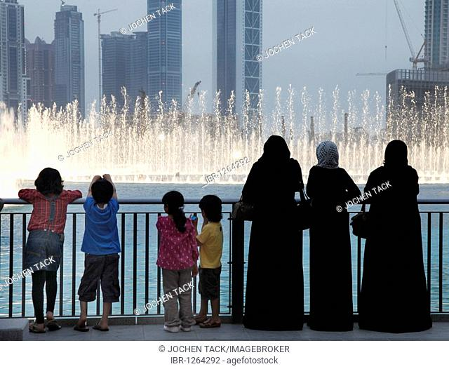 Fountain at Lake Dubai, world's largest fountain, evening show, in Downtown Dubai, United Arab Emirates, Middle East