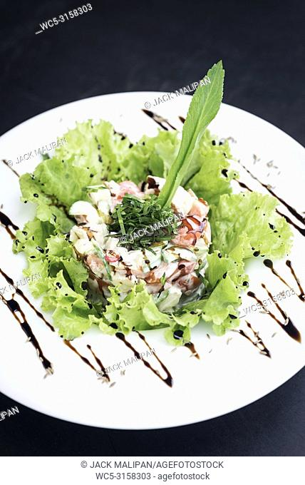 gourmet prawn cocktail salad with apple celery and spicy yoghurt sauce
