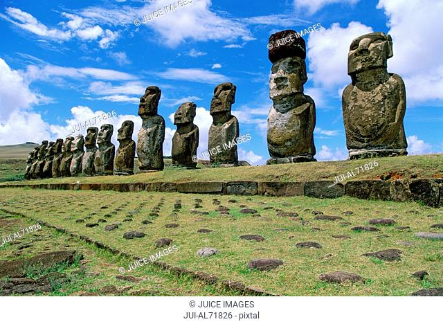 View of moai statues against blue sky, Chile, Easter Island (Rapa Nui)