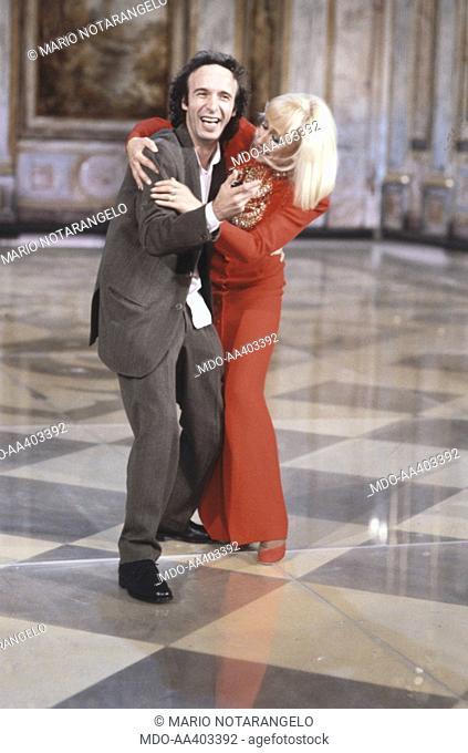 Raffaella Carrà hugging Roberto Benigni in Fantastico 12. Italian showgirl Raffaella Carrà (Raffaella Maria Roberta Pelloni) hugging Italian actor and director...