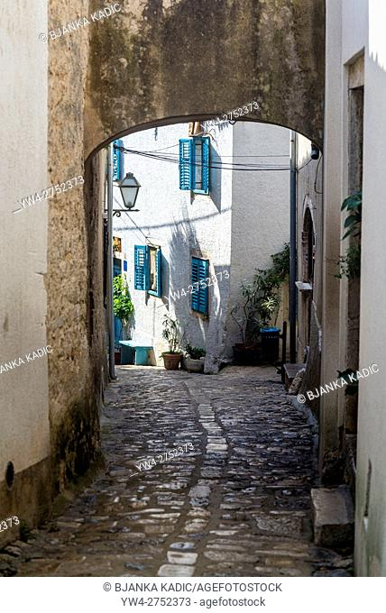 Narrow lane with cobblestones in the Old Town, Town of Krk on the island of Krk, Croatia