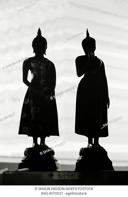 Figures at Wat Rakhang Bell Temple in Bangkok in Thailand in Southeast Asia Far East