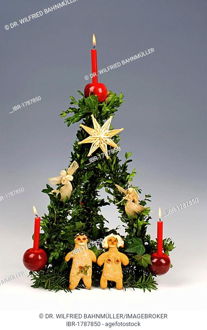 Christmas pyramid, Paradeiserl, predecessor of the Christmas tree, with Adam and Eve pastry figurines at the base
