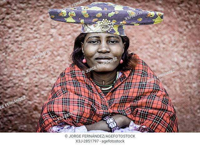 Portrait of a Herero woman with typical hat and dress