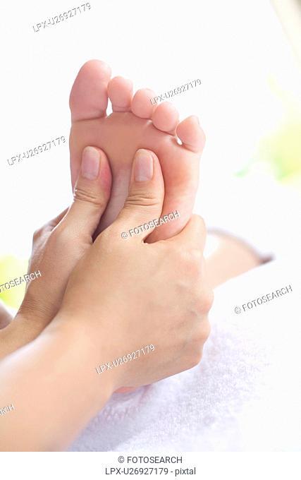 Young woman getting a Foot Massage, Saipan