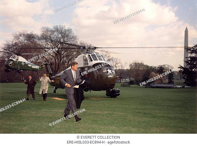 President Kennedy returning to the White House via Marine Helicopter. He is followed Secret Serviced Chief, Jerry Behn, and Press Secretary, Pierre Salinger