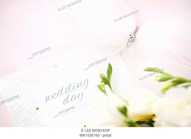 a card saying wedding day next to a bunch of flowers
