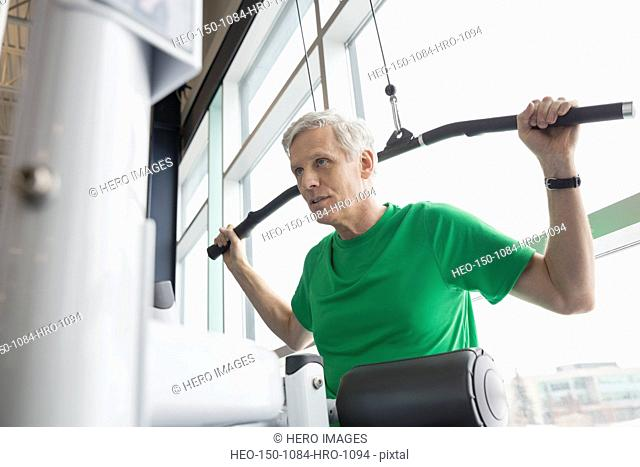 Man using weight machine at gym