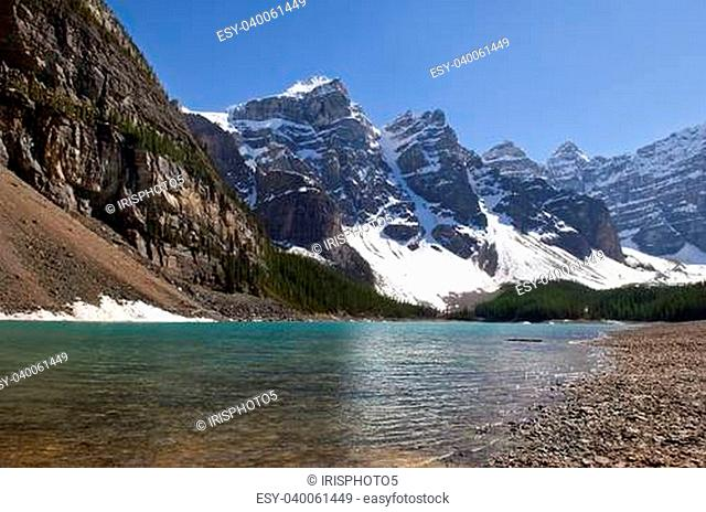 magnificent views of the Canadian Rocky Mountains and glacial lake at the foot of them, Alberta, Canada