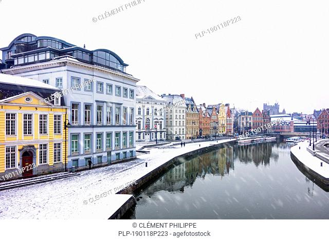 Korenlei along the river Lys / Leie in the snow in winter in the city Ghent, East Flanders, Belgium