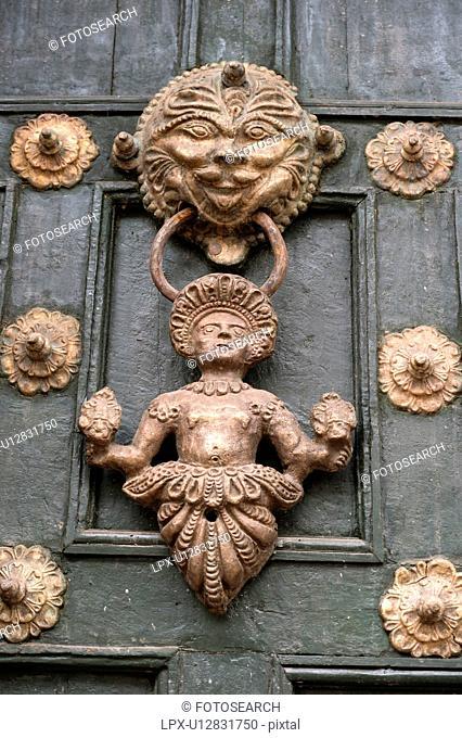 Door knocker of a door, Cuzco, Peru
