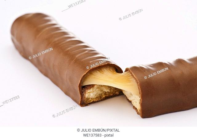 chocolate bar filled with caramel and biscuit; halved