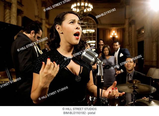 Woman singing in nightclub